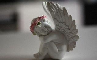 Le baptême de Tessa sur le thème des anges et du liberty
